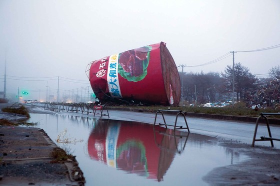 A whale meat tin, previously used as an advertisement, remains as a memorial on the spot where it was washed into the road during the tsunami in Ishinomaki, Japan, March 2012. Photo: David Shadi Perez