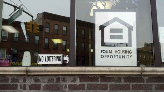 FIgure 2: Two ubiquitous signs advertising two very different—if not contradictory—sentiments. Courtesy Interboro Partners