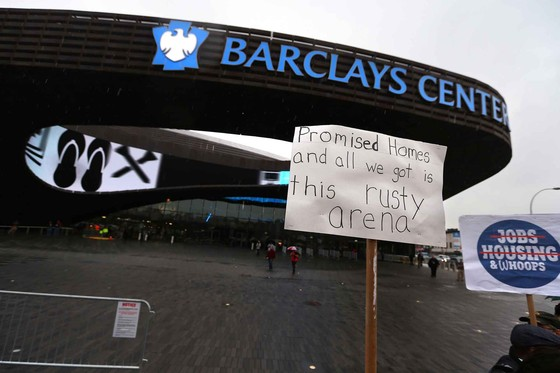 A protester's sign outside of the Barclays Center on opening day in New York, Sept. 28, 2012. (c) Chang W. Lee/The New York Times