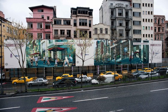 Istanbul, Turkey, April 9, 2012. Urban transformation in Istanbul: Houses waiting for demolition in the impoverished quarter of Tarlabasi, in the rapidly gentrifying central Beyoglu district. New luxury housing, as shown on the billboards, are meant to attract middle class citizens, to start a process of gentrification in this area. © Nick Hannes