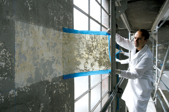 Jorge Otero-Pailos cleaning the wall of Alumix Factory, Bolzano, Italy, 2008.