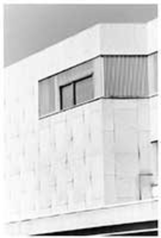 Alvar Aalto, Finlandia Concert Hall, Helsinki, Finland, completed 1971; this 1995 photograph shows the bowing of marble panels.